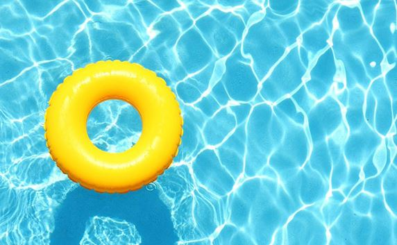 Yellow raft floating in pool